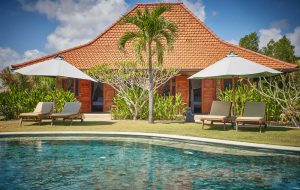THREE MONKEY VILLAS uluwatu bungalows around a pool in landscaped gardens